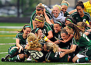 Waubonsie Valley High School girls soccer player's pile on teammate Vanessa DiBernardo after she scored a goal in the 119th minute of play in the fourth overtime period against Neuqua Valley High School  to give Waubonsie a 2-1 win over Neuqua in Bolingbrook, Ill.