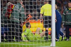 LONDON, ENGLAND - Saturday, November 22, 2014: Arsenal's goalkeeper Wojciech Szczesny lies injured during the Premier League match against Manchester United at the Emirates Stadium. (Pic by David Rawcliffe/Propaganda)