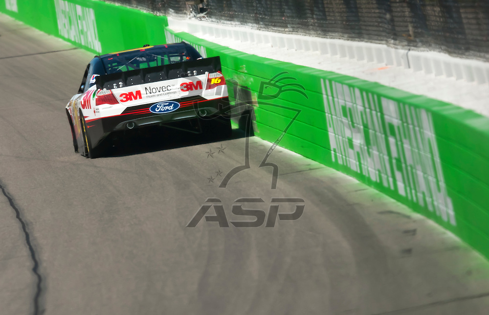 KANSAS CITY, KS - APR 20, 2012:  Greg Biffle (16) brings his car through the turns during a practice session for the STP 400 at the Kansas Speedway in Kansas City, KS.