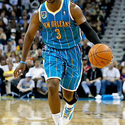 October 29, 2010; New Orleans, LA, USA; New Orleans Hornets point guard Chris Paul (3) controls the ball during the fourth quarter against the Denver Nuggets at the New Orleans Arena. The Hornets defeated the Nuggets 101-95.  Mandatory Credit: Derick E. Hingle
