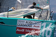Quantum Racing prepare to set the Spinnaker during the Practice race of the AUDI Medcup in Cagliari