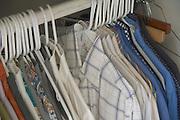 men shirts hanging in a closet