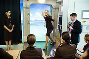 ABU DHABI, UAE - FEBRUARY 8, 2015: Flight attendants are going through a safety course at the training academy. Different scenarios are proposed to evaluate the students.