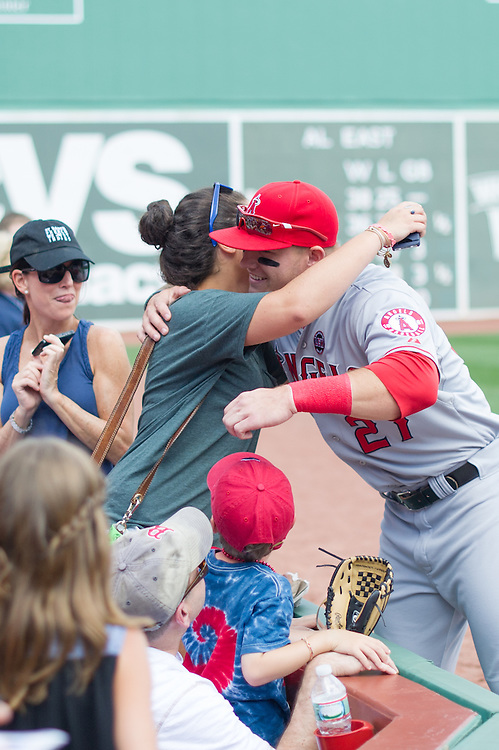 BOSTON, MA - JUNE 09: Mike Trout #27 of the Los Angeles Angels exchanges emotion with a fan before the game against the Boston Red Sox at Fenway Park in Boston, Massachusetts on June 9, 2013. (Photo by Rob Tringali) *** Local Caption *** Mike Trout
