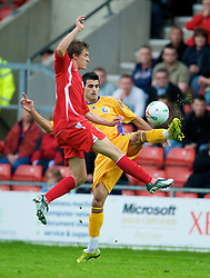 WREXHAM, WALES - Wednesday, August 20, 2008: Wales' Aaron Ramsey in action against Romania's Hristu Chiacu during the UEFA Under 21 European Championship Qualifying Group 10 match at the Racecourse Ground. (Photo by David Tickle/Propaganda)