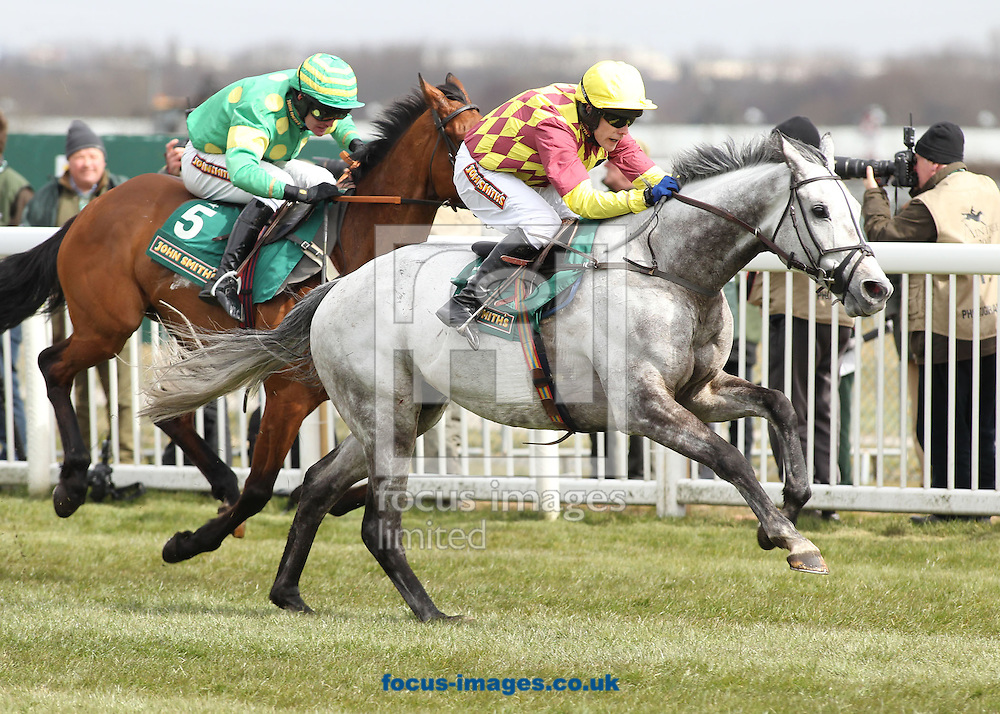 Picture by Michael Sedgwick/Focus Images Ltd +44 7900 363072.05/04/2013.Dynaste ridden by Tom Scudamore breaks away from Third Intention ridden by Joe Tizzaed before going on to win The John Smith's Mildmay Novices Steeple Chase on the John Smith's Grand National Meeting Day Two, Ladies' Day, at Aintree Racecourse, Aintree.