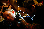 Patrons show off and get tattoos during the 9th Annual New York City Tattoo Convention in New York May 20, 2006. Photo by Keith Bedford