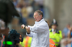 WIGAN, ENGLAND - Sunday, May 11, 2008: Manchester United's manager Alex Ferguson checks his watch for 'Fergi-time' during the final Premiership match of the season at the JJB Stadium. (Photo by David Rawcliffe/Propaganda)
