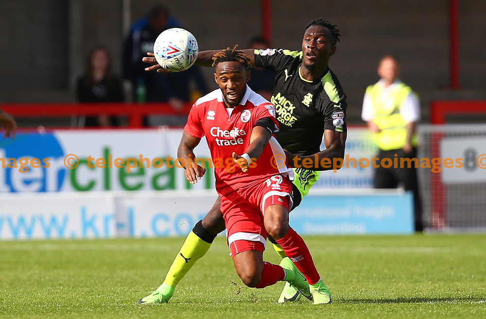 Adebayo Azeez of Cambridge vies for the ball Cedric Evina of Crawley  during the Sky Bet League 2 match between Crawley Town and Cambridge United at the Checkatrade Stadium in Crawley. 19 Aug 2017
