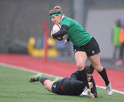 Ireland women's Alison Miller attempted tackle by Wales women's Rebecca De Filippo<br /> <br /> Photographer Mike Jones/Replay Images<br /> <br /> International Friendly - Wales women v Ireland women - Sunday 21st January 2018 - CCB Centre for Sporting Excellence - Ystrad Mynach<br /> <br /> World Copyright © Replay Images . All rights reserved. info@replayimages.co.uk - http://replayimages.co.uk