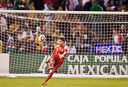 February 24, 2010; San Francisco, CA, USA;  Mexico goalkeeper Luis Ernesto Michel (1) punts the ball against Bolivia during the second half at Candlestick Park. Mexico defeated Bolivia 5-0.