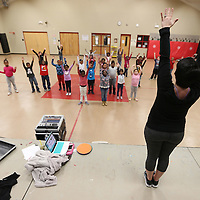 Adam Robison | BUY AT PHOTOS.DJOURNAL.COM<br /> Mary Frances Massey leads a a group of second graders in a dance routine Tuesday morning at Parkway Elementary School in Tueplo.