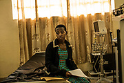 Elina Mukagasigwa sits after having her vitals taken during a screening for Rheumatic heart disease at the University Teaching Hospital of Kigali in Rwanda.<br /> <br /> Rheumatic heart disease is damage to one or more heart valves that stems from inadequately treated strep throat. Left untreated, rheumatic heart disease leads to heart failure.