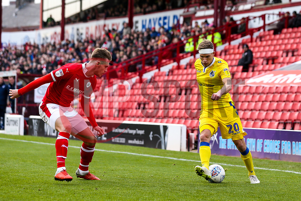 Gavin Reilly of Bristol Rovers takes on Liam Lindsay of Barnsley - Mandatory by-line: Robbie Stephenson/JMP - 27/10/2018 - FOOTBALL - Oakwell Stadium - Barnsley, England - Barnsley v Bristol Rovers - Sky Bet League One