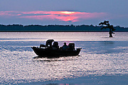 Fisherman at sunset getting ready to call it a day. Reel Foot lake, near Tiptonville, TN. Reel Foot Lake