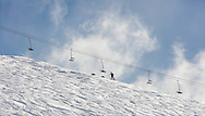 Skier ascends peak at Arctic Valley Ski Area in Arctic Valley near Anchorage in Sourhcentral Alaska. Spring. Afternoon.