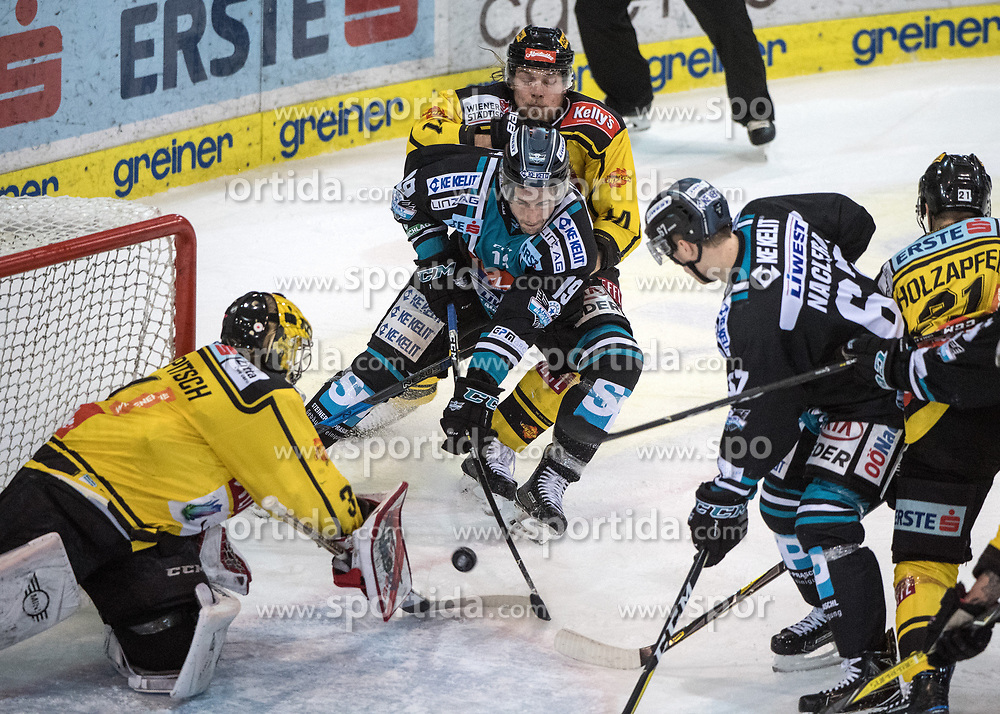 11.02.2018, Keine Sorgen Eisarena, Linz, AUT, EBEL, EHC Liwest Black Wings Linz vs Vienna Capitals, Platzierungsrunde, im Bild Tormann Matthias Tschrepitsch (Vienna Capitals) und Joel Broda (EHC Liwest Black Wings Linz) // during the Erste Bank Icehockey League placement round between EHC Liwest Black Wings Linz and Vienna Capitals at the Keine Sorgen Icearena, Linz, Austria on 2018/02/11. © 2018, PhotoCredit: EXPA/ Reinhard Eisenbauer