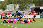 George Francomb, opens for the dons and celebrates with team, during the Sky Bet League 2 match between AFC Wimbledon and Exeter City at the Cherry Red Records Stadium, Kingston, England on 29 August 2015. Photo by Stuart Butcher.