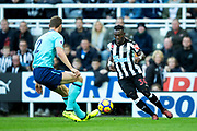 Christian Atsu (#30) of Newcastle United takes on Simon Francis (#2) of AFC Bournemouth during the Premier League match between Newcastle United and Bournemouth at St. James's Park, Newcastle, England on 4 November 2017. Photo by Craig Doyle.