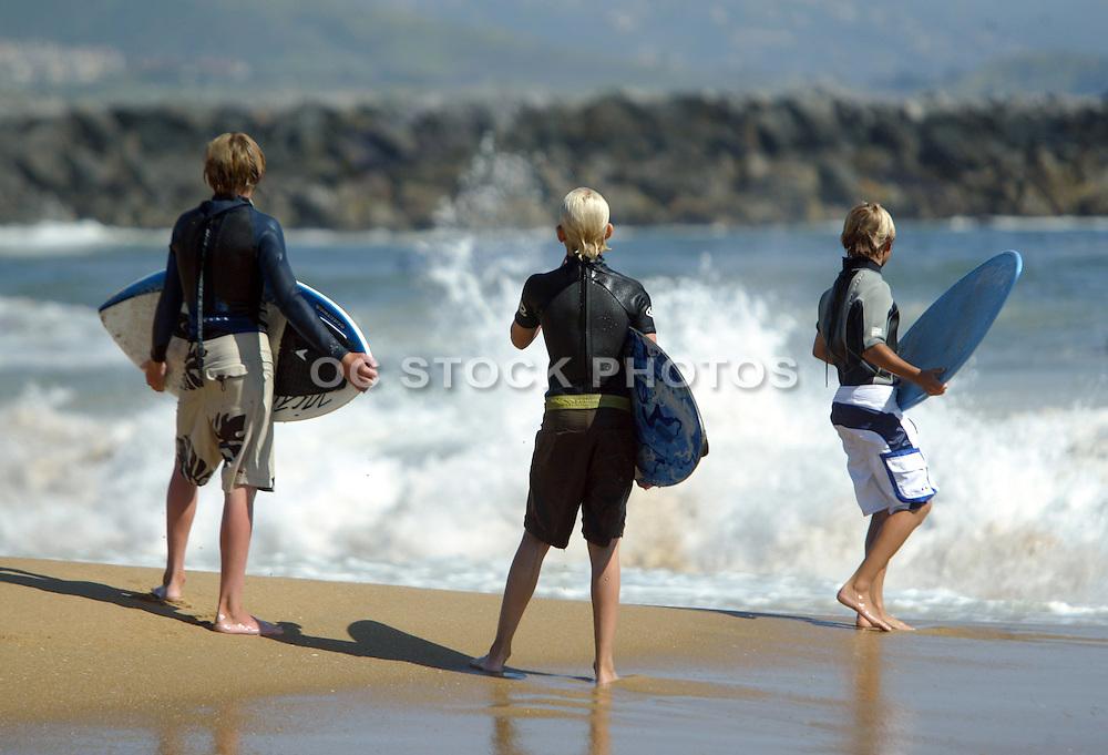 Kids At the beach Skim Boarding
