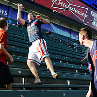 CLEVELAND, OH USA - JULY 6: Fans catch balls in the bleachers during the New York Yankees batting practice before the game between the Cleveland Indians and the New York Yankees at Progressive Field in Cleveland, OH, USA on Wednesday, July 6, 2011.