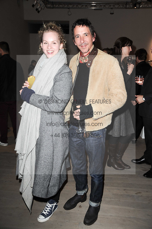 HATTIE GALLAGHER and JULIAN BROAD at a private view of Masters of Photography - A Journey presented by Macallan and Albert Watson held at Philips De Pury, Howick Place, London SW1 on 1st December 2010.