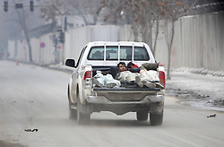 Victims of a suicide car bombing are seen inside a military vehicle towards hospital in Kabul, Afghanistan, on Jan. 16, 2013. A powerful blast rocked Afghan capital Kabul on Wednesday leaving over a dozen dead and injured, an eye witness said,  January 16, 2013. Photo by Imago / i-Images...UK ONLY