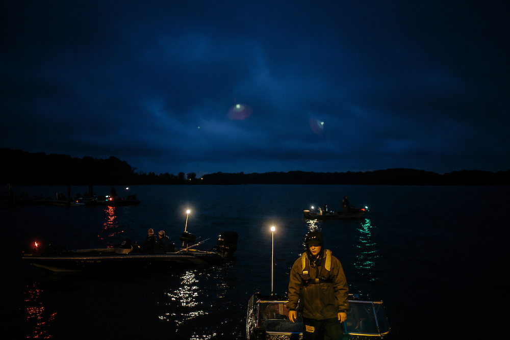 Teams, including Tyler Sheppard from Slippery Rock University, center, wait for the announcer to call their boat to the starting line during the FLW College Fishing Northern Conference Invitational in Marbury, MD on Oct. 11, 2014. Only the top 15 of 43 teams moved on to Sunday.