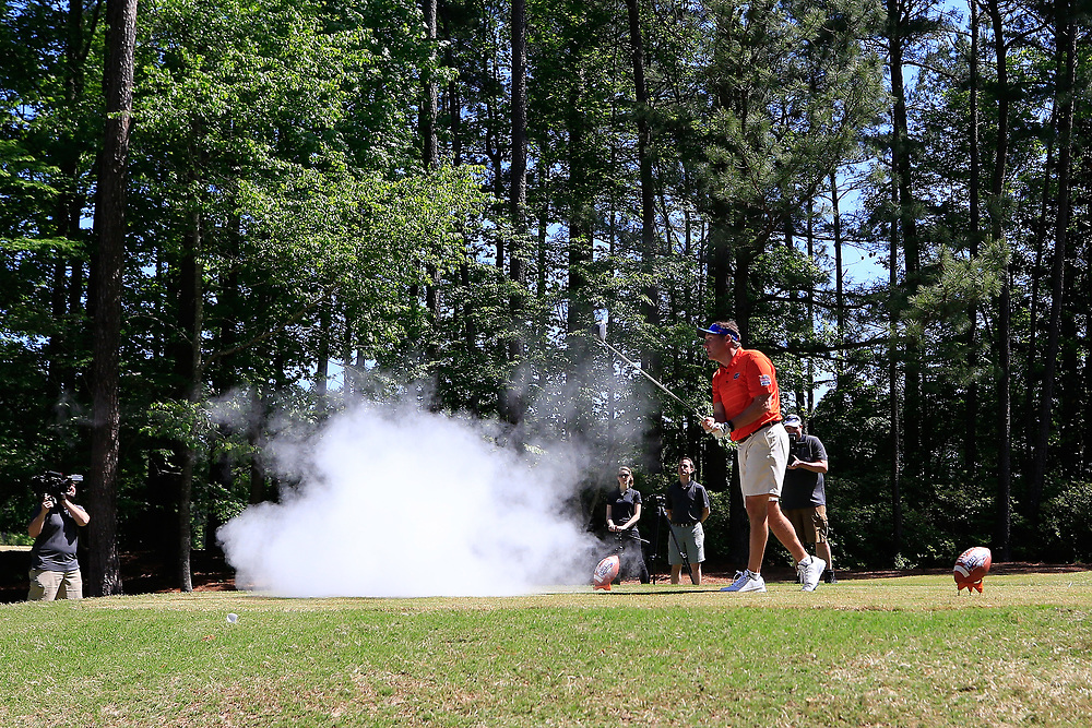 Dan Mullen is pranked with an exploding golf ball during the Chick-fil-A Peach Bowl Challenge at the Oconee Golf Course at Reynolds Plantation, Sunday, May 1, 2018, in Greensboro, Georgia. (Paul Abell via Abell Images for Chick-fil-A Peach Bowl Challenge)