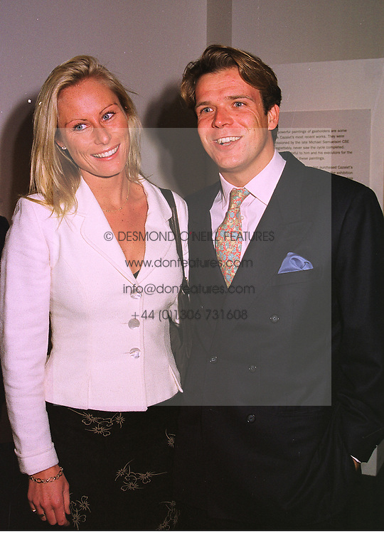 MR JOEL CADBURY and MISS KATRINA FLEMING a member of the banking family, at an exhibition in London on 26th October 1998.MLF 22