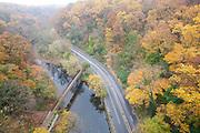 Deciduous woods autumn; Wissahickon Creek; from Wissahickon Memorial Brige, Henry Avenue; PA, Philadelphia; Fairmount Park