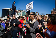 State Senator Lena Taylor cheers on high school students marching on the State Capitol in support of stronger gun regulation and legislation in Madison, Wisconsin, Wednesday, March 14, 2018.