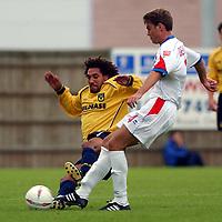 Photo: Daniel Hambury.Digialsport<br /> Coca Cola League Two<br /> Oxford United V Rushden & Diamonds .  11/9/2004.<br /> <br /> <br /> Oxford United's Rob Wolleaston and Rushden & Diamonds' John Dempster