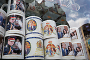 A week before royal wedding between Prince Harry and Meghan Markle, their faces adorn mugs in the window of a tourist trinket shop near Piccadilly Circus, on 1st May, in London, England.
