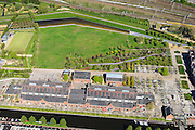 Nederland, Noord-Holland, Amsterdam, 09-04-2014;<br /> Detail Cultuurpark Westergasfabriek en Westerpark op het voormalige  Westergasterrein, langs de Haarlemmertrekvaart en de Haarlemmerweg. Spoor met trein boven in beeld.<br /> Buildings of Culture park Westergasfabriek and the Westerpark on the former Westergasterrein (gasworks).luchtfoto (toeslag op standard tarieven);<br /> aerial photo (additional fee required);<br /> copyright foto/photo Siebe Swart