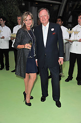 COUNTESS MAYA VON SCHONBURG and ANDREW PARKER-BOWLES at a dinner hosted by Cartier in celebration of the Chelsea Flower Show held at Battersea Power Station, 188 Kirtling Street, London SW8 on 23rd May 2011.