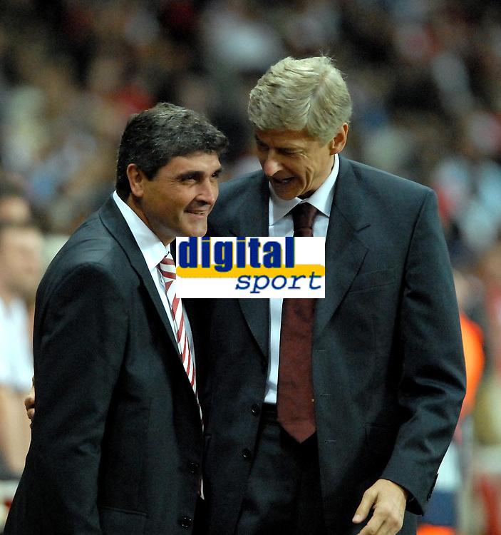 Photo: Ed Godden/Sportsbeat Images.<br /> Arsenal v Sevilla. UEFA Champions League Group H. 19/09/2007. Sevilla Coach, Juande Ramos (L), chats to Arsenal Manager, Arsene Wenger before the match.