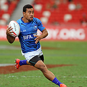 Tomasi Alosio seals the 28-14 victory over Fiji for Manu Samoa with his 2nd half try at the Singapore 7's, day 1, Singapore National Stadium, Singapore.  Photo by Barry Markowitz, 4/16/16
