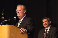 Former Congressman and former U.S. Ambassador Tony P. Hall (left) speaks after receiving the lifetime achievement award during the Montgomery County Democratic Party's annual Frolic for Funds at the Dayton Convention Center in downtown Dayton, Thursday, March 29, 2012.  Behind him is MC Karl Keith.
