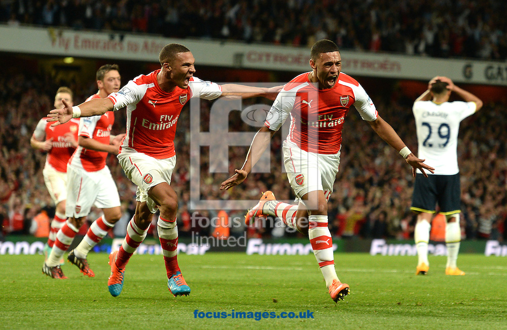 Alex Oxlade-Chamberlain of Arsenal celebrates scoring their first goal during the Barclays Premier League match against Tottenham Hotspur at the Emirates Stadium, London<br /> Picture by Andrew Timms/Focus Images Ltd +44 7917 236526<br /> 27/09/2014