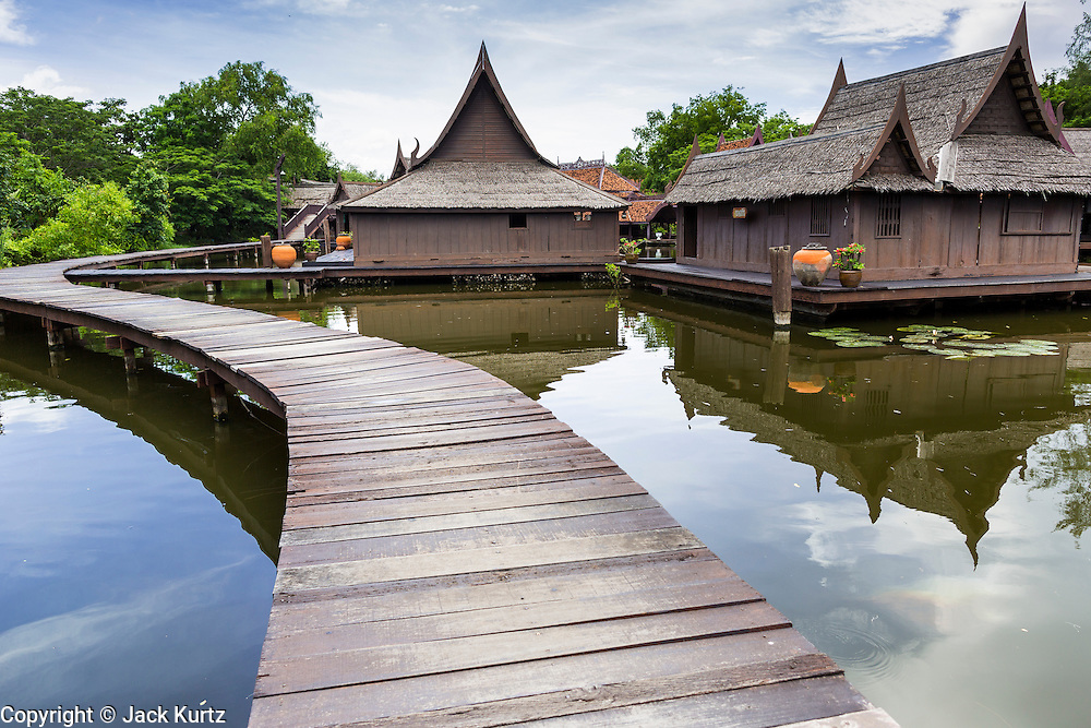 16 JULY 2014 - SAMUT PRAKAN, SAMUT PRAKAN, THAILAND: A walkway through the floating village in Ancient Siam. Ancient Siam is a historic park about 200 acres (81 hectares) in size in the city of Samut Prakan, province of Samut Prakan, about 90 minutes from Bangkok. It features historic recreations of important Thai landmarks and is shaped roughly like the country of Thailand.      PHOTO BY JACK KURTZ