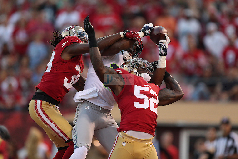 San Francisco 49ers linebacker Patrick Willis (52) breaks up a pass to Seattle Seahawks wide receiver Braylon Edwards (17) on Thursday, Oct. 18, 2012 at Candlestick Park in San Francisco. (AP Photo/Jed Jacobsohn)
