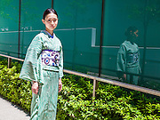 JAPAN, TOKYO -  Kururi Kimono from the shop in Omotesando - Shooting in front of Ajisai hydrangea blue flowers 06-2014