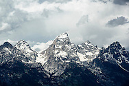 Grand Teton mountain peak with dramatic sky.