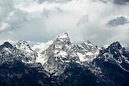 Grand Teton mountain peak with dramatic sky.