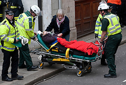 © Licensed to London News Pictures. 22/02/2012. London, UK.  Police and paramedics attend to an actor playing an injured woman on a stretcher during an Olympic security test event at Aldwych tube station in central London today (22/02/2012). The  two-day exercise is being run in a disused tube station to test security in run up to the London Olympics this summer. Photo credit : Ben Cawthra/LNP