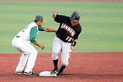 11 July 2012:  Joash Brodin (London Rippers) rises back up from a successful slide into second as a late tag gets applied by Hector Pellot (Joliet Slammers) during the Frontier League All Star Baseball game at Corn Crib Stadium on the campus of Heartland Community College in Normal Illinois
