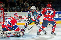 KELOWNA, CANADA - MARCH 5: Eric Williams #35 of the Spokane Chiefs deflects a shot from Rourke Chartier #14 of the Kelowna Rockets as he is checked by Mitch Holmberg #17 of the Spokane Chiefs during third period on March 5, 2014 at Prospera Place in Kelowna, British Columbia, Canada.   (Photo by Marissa Baecker/Getty Images)  *** Local Caption *** Eric Williams; Rourke Chartier; Mitch Holmberg;
