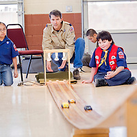 020213       Cable Hoover<br /> <br /> Cubmaster Stephen Novotny, center, moves to catch the cars of Cub Scouts Cody Koons, right, Ryaln Lantone and Richard Quam during the troop's pinewood derby in Zuni Saturday.