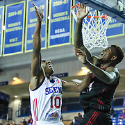 Delaware 87ers Guard Nolan Smith (10) drives towards the basket as Sioux Falls Skyforce Guard Fuquan Edwin (17) defends in the first half of a NBA D-league regular season basketball game between the Delaware 87ers (76ers) and the Sioux Falls Skyforce (Miami Heat) Tuesday, Dec. 2, 2014 at The Bob Carpenter Sports Convocation Center in Newark, DEL